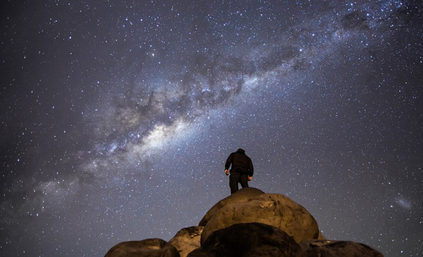 This image is shot only 15 minutes from the CBD in Wellington, New Zealand. The south coast of Wellington is dark and remote, but easily acessable, and it's a place I spend a lot of time at night taking photos and watching the stars. I was shooting a timelapse this night and decided to climb up the rocks and stand there watching and admiring the sky above. For me, star gazing really puts into perspective just how small we are in the grand scheme of things, and just how vast the mind boggling the universe really is.