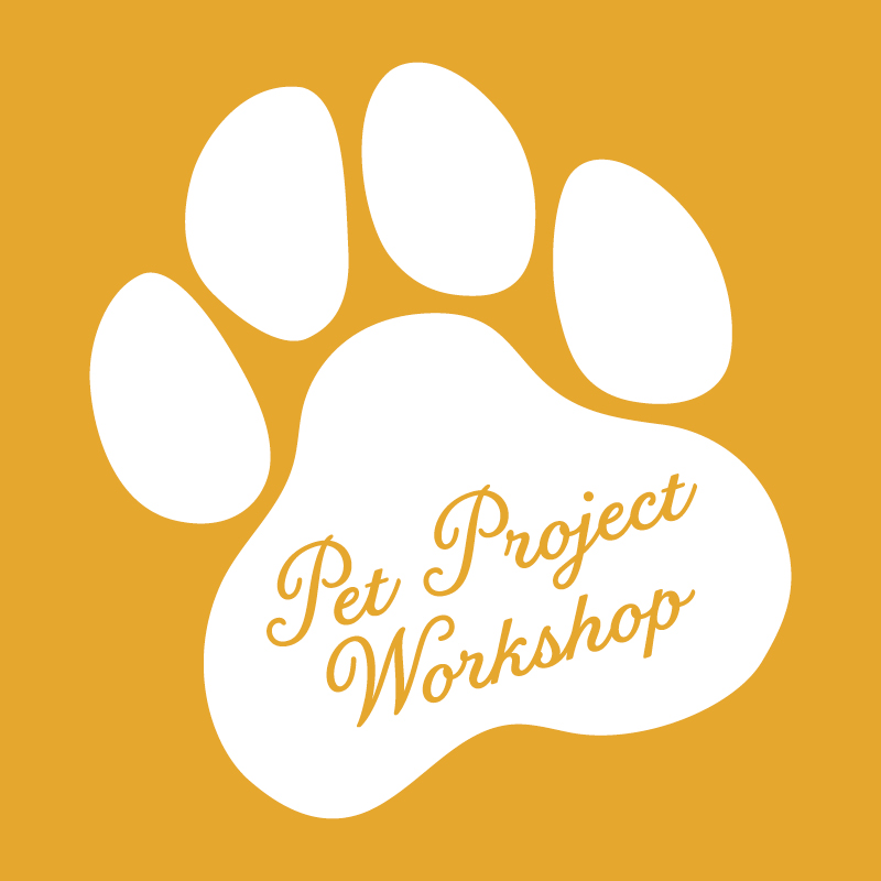 A white paw print on an orange background